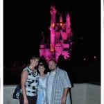 NickChristinaandBrandon in front of the castle disney